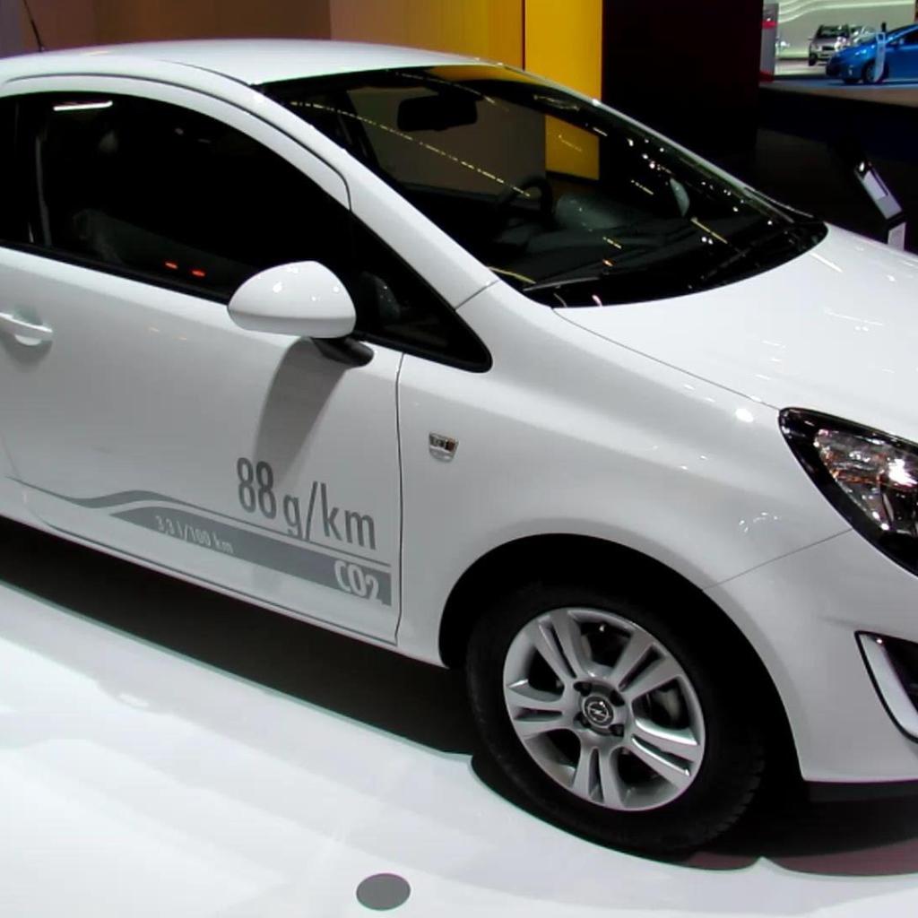 Opel Car Wallpaper: Opel Corsa Car On The Road Desktop Wallpapers 1024x1024