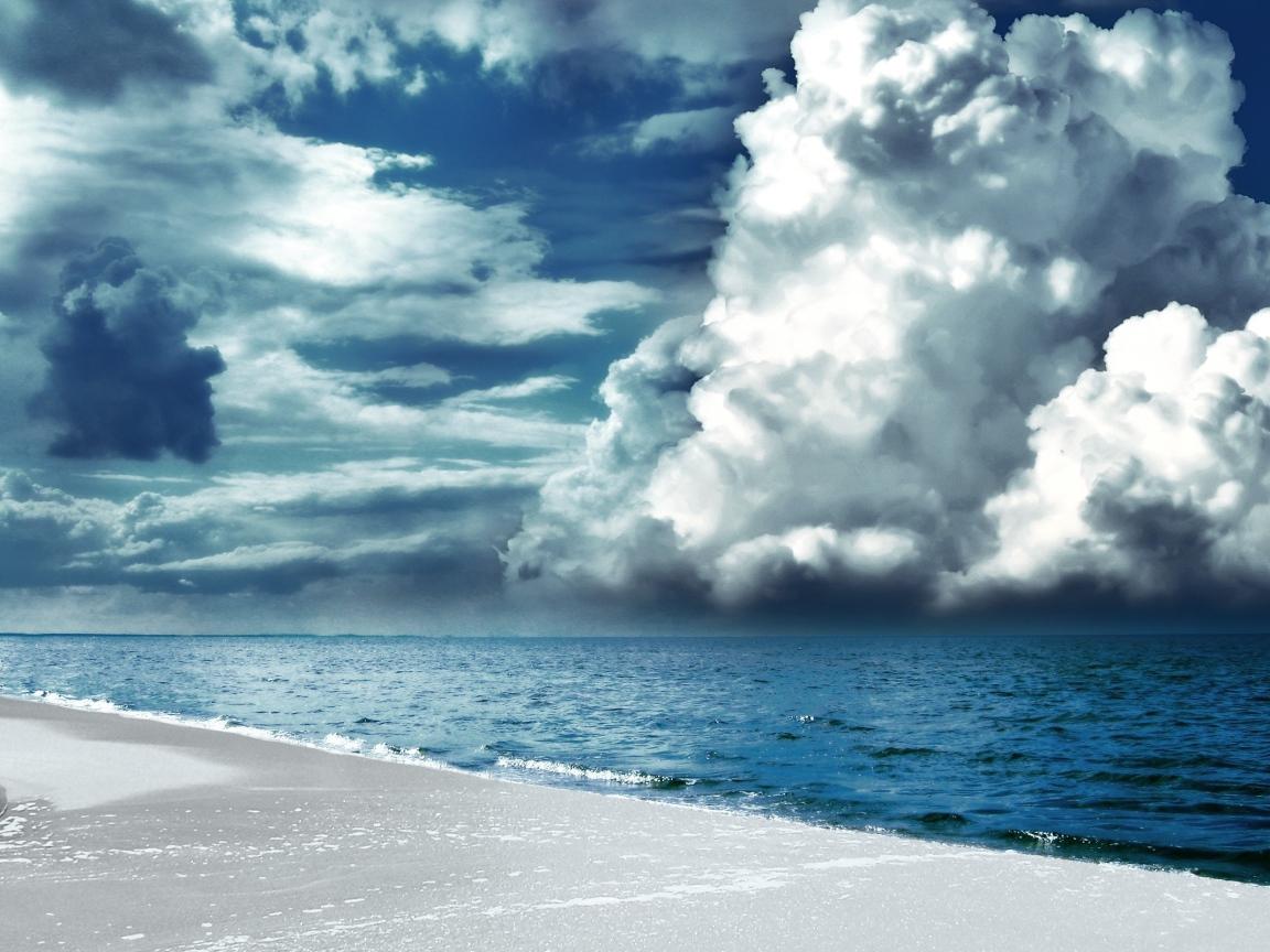 White sand, sea, overcast sky