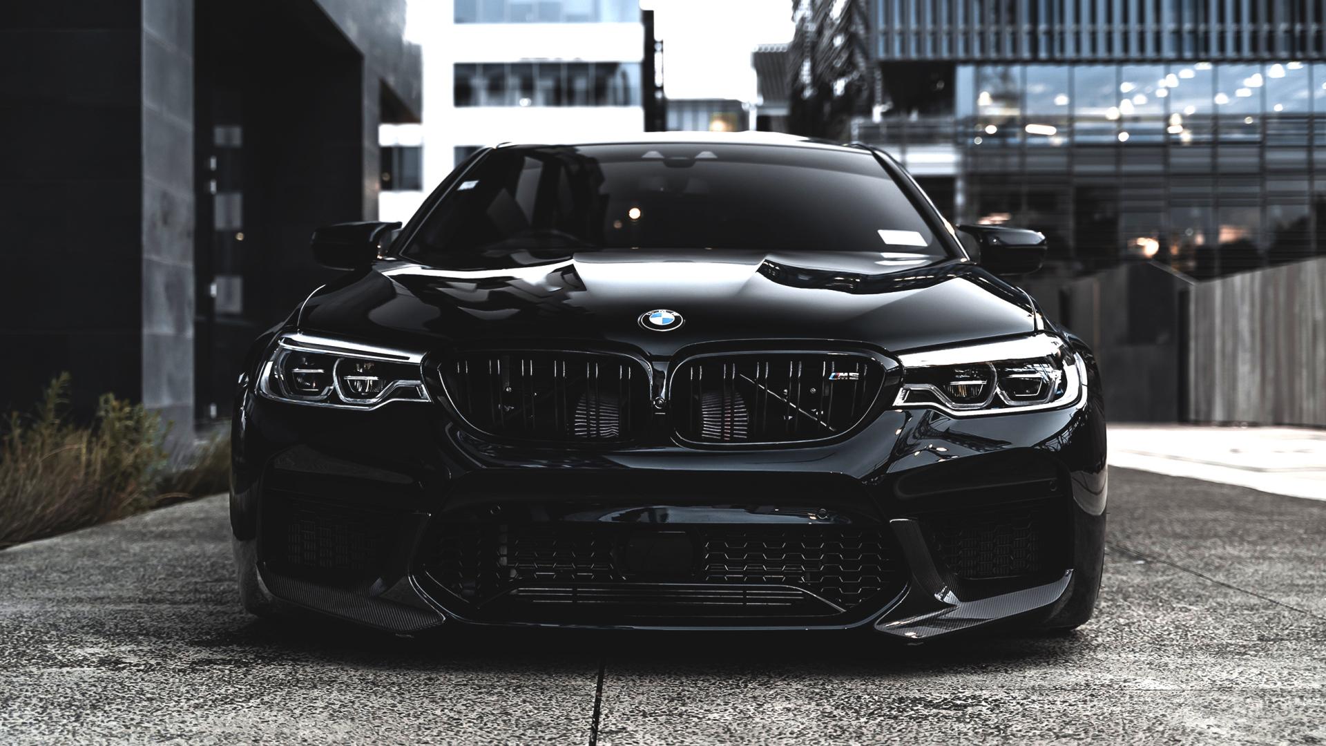 Stylish black BMW M5 in the street