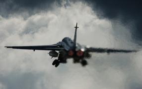 SU-24 in the clouds
