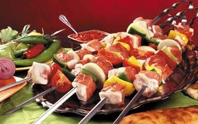 With a shish kebab skewer