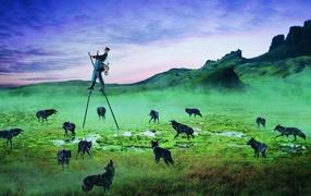Hunter on stilts and wolves