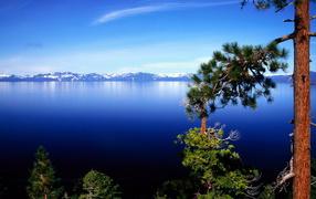 On background mountain lake