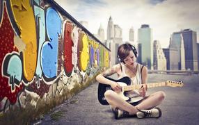 Guitar, wall, headphones