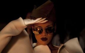 Rihanna posing like soldier