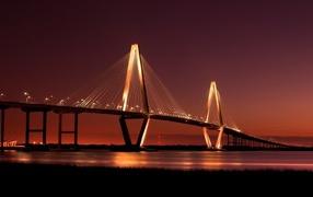 The bridge is lit at night