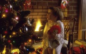 Kid at the Christmas tree