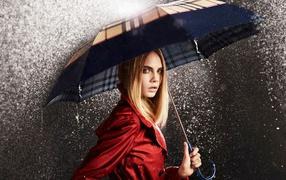 Beautiful girl under an umbrella