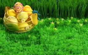 Basket of eggs on green grass for Easter