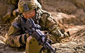 A soldier with a machine gun