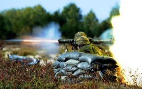 Shooting a grenade launcher