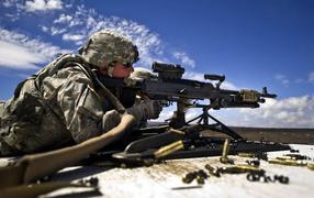 The firing of a machine gun