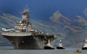 Aircraft carrier near the shore