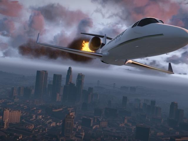 Обои самолет горит над городом
