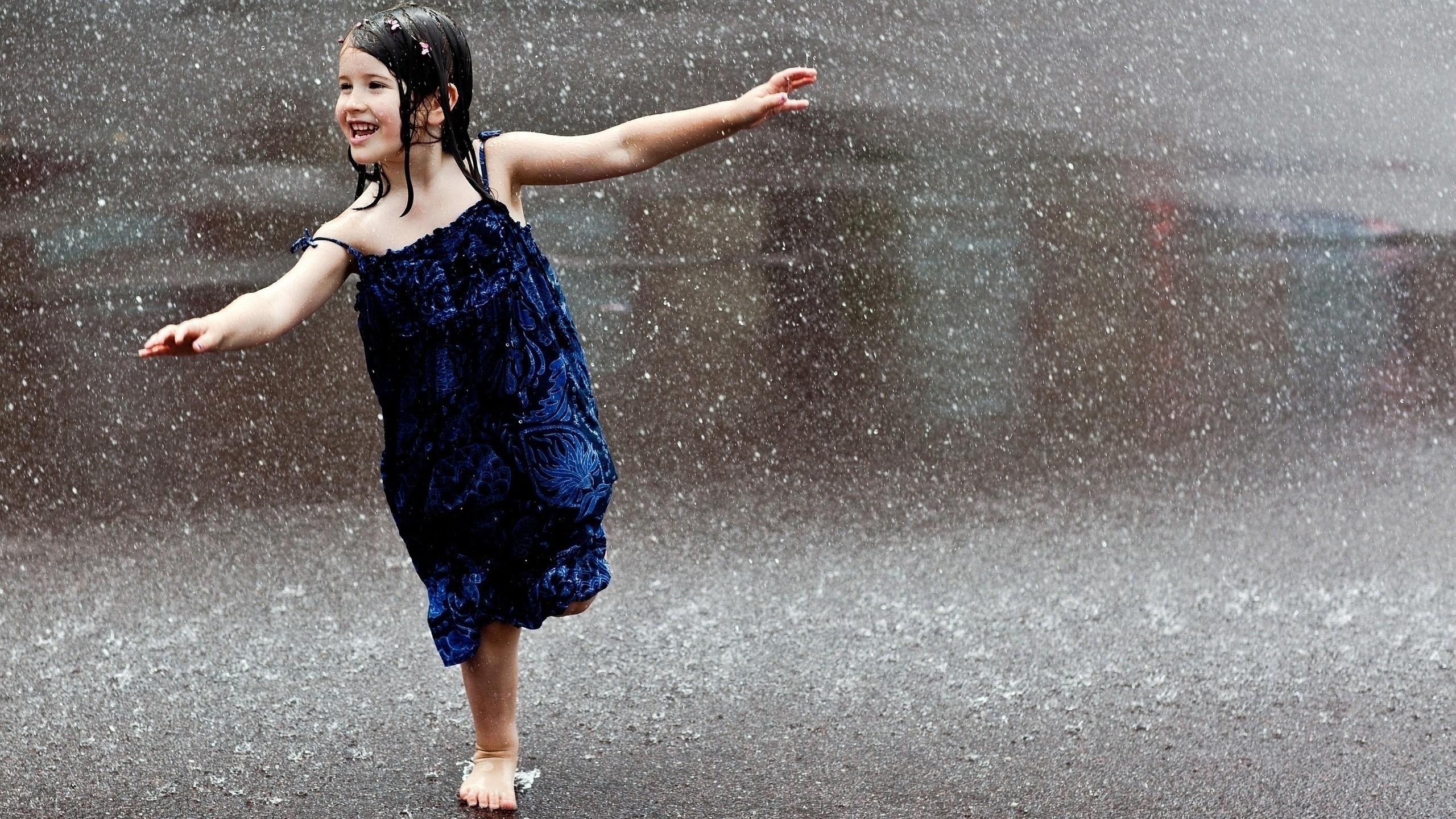 People___Children_Happy_child_runs_in_the_rain_071448_.jpg