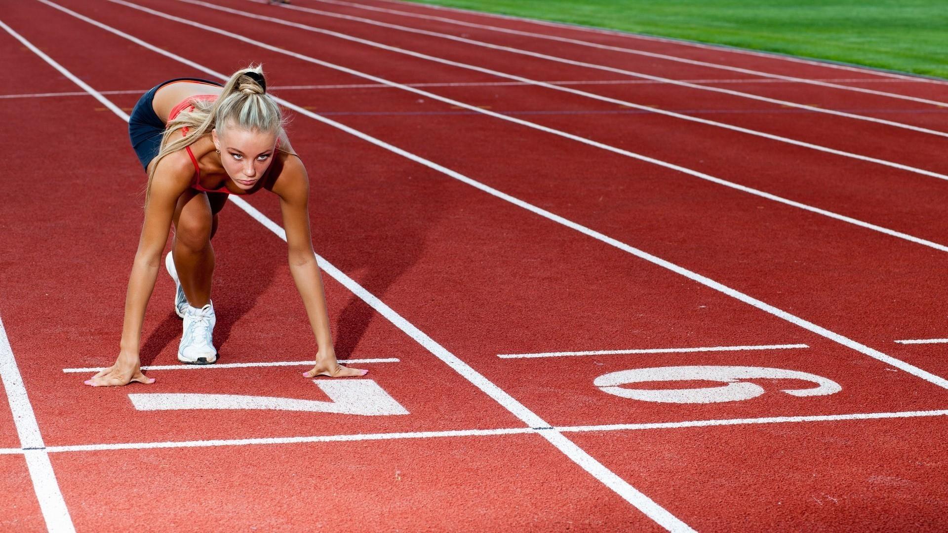 Female Runner At The Start